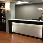 reception desk with accent lighting and display cabinets